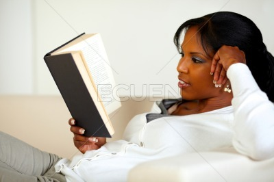Relaxed young woman reading a book