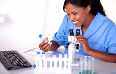 Scientific young woman working at laboratory