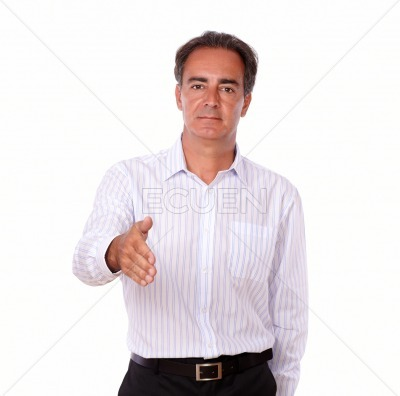 Serious hispanic man with greeting gesture