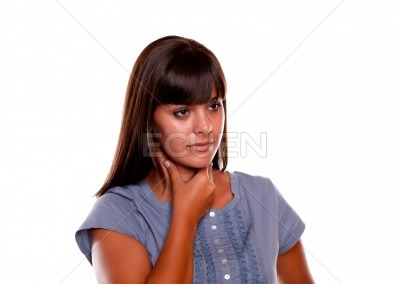 Sick young woman with pain throat on blue shirt