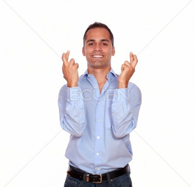 Smiling adult man crossing his fingers