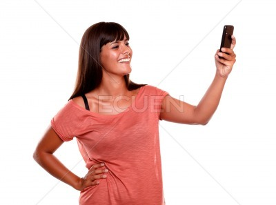 Smiling woman taking a photo with her cellphone