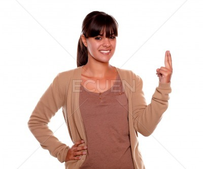 Smiling young female crossing her fingers for luck