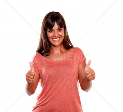 Smiling young woman giving you two thumbs up