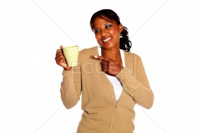 Smiling young woman looking and pointing a mug