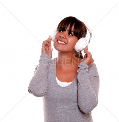 Smiling young woman with headphone listening music