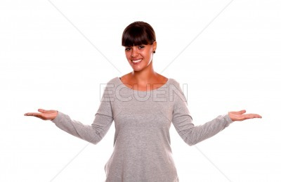 Smiling young woman with the palms upward