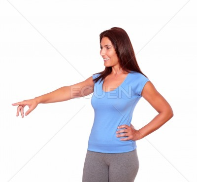 Sporty senior woman in gym clothing pointing right