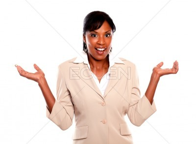 Stylish businesswoman looking at you with arms up