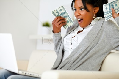 Surprised woman holding plenty of cash money