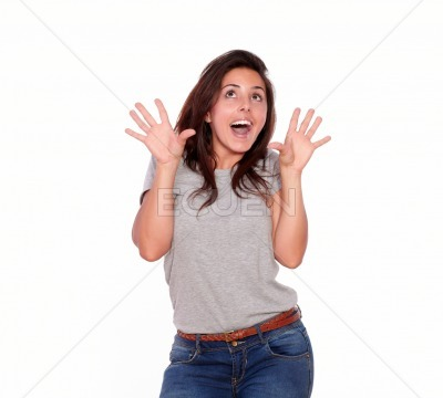 Surprised woman in jeans screaming with hands up