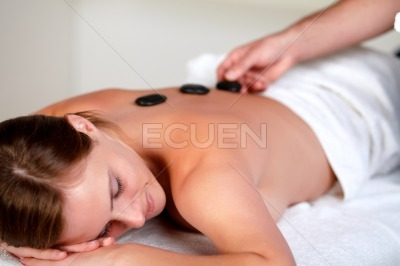 Tired young woman relaxing at a spa