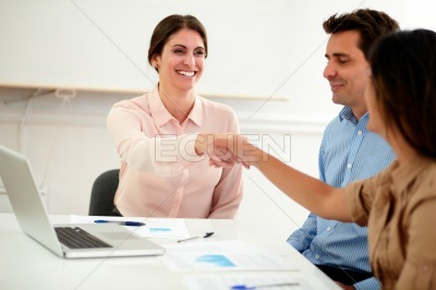Two female coworkers making an agreement