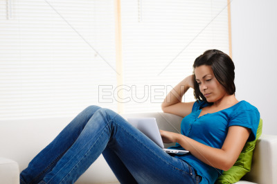 Woman concentrated while using a laptop