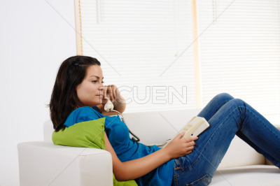 Woman lying on a couch