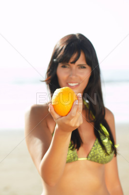 Women offering you an orange