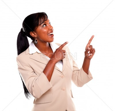 Young businesswoman looking and pointing up