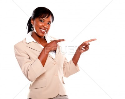 Young businesswoman looking at you pointing left