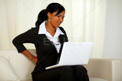 Young businesswoman with back pain