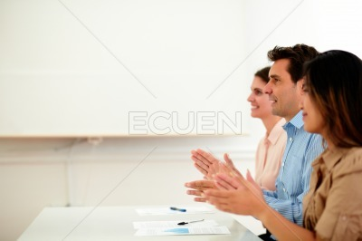 Young coworkers team giving applause on office