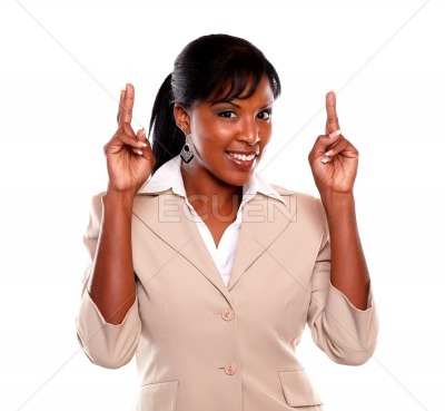 Young executive woman crossing fingers