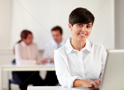 Young executive woman working with her laptop
