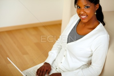 Young female looking at you browsing the Internet