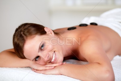 Young female smiling and relaxing at spa