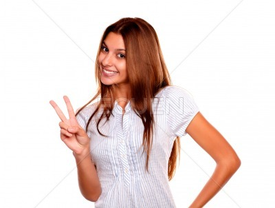 Young female smiling and showing you victory sign
