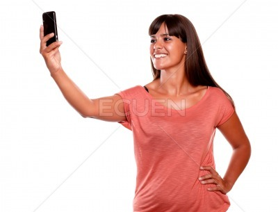Young female taking a picture with her cellphone