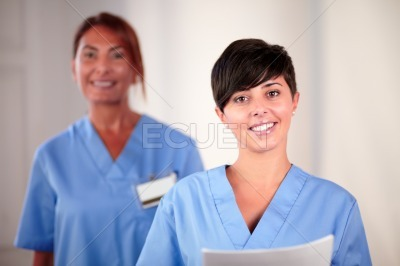 Young hispanic nurse holding a documents