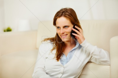Young lady enjoying conversation on cell phone