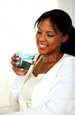 Young pretty lady smiling and drinking water