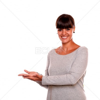 Young woman holding out her palm copyspace