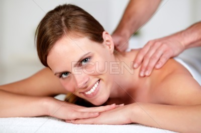 Young woman receiving a body massage at a spa