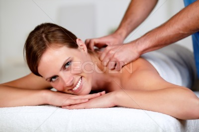 Young woman receiving a relaxed massage at a spa