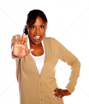 Young woman screaming and giving the high