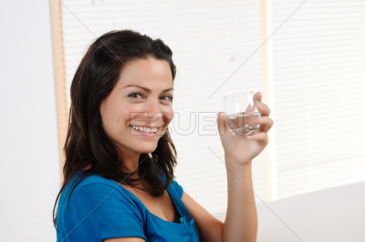 Young woman smiling with glass
