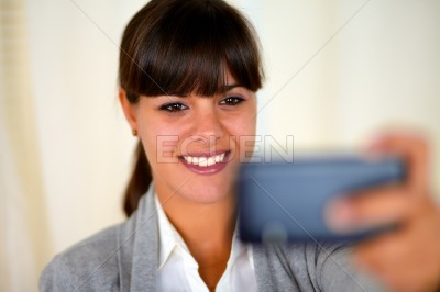 Young woman taking a photo with cellphone