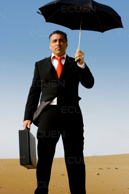 A business man with a briefcase and a umbrella stock photo