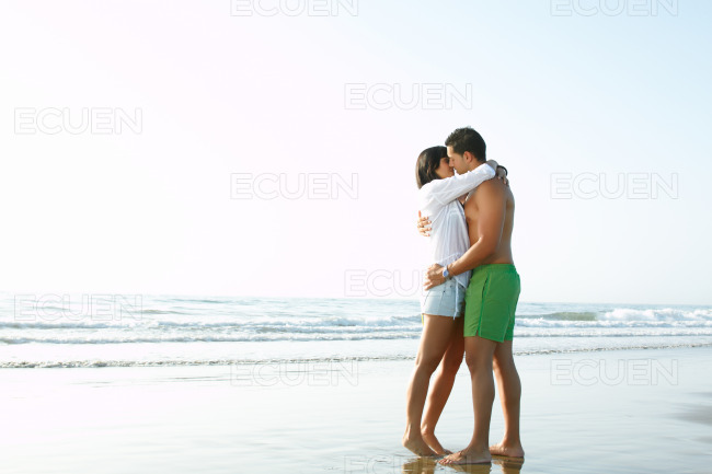 Adorable couple in love kissing and embracing each other stock photo