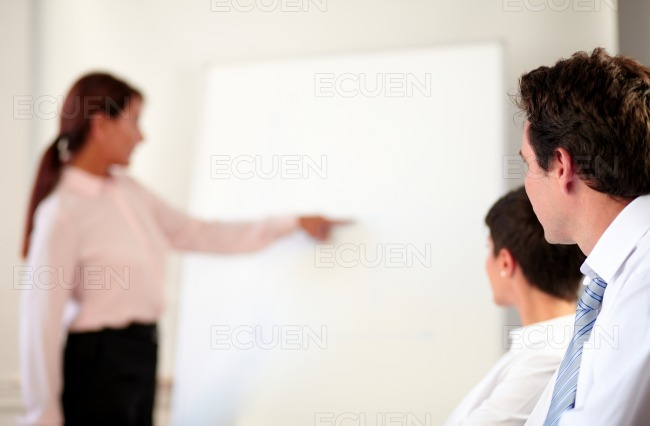 Adult coworker group listening to a presentation