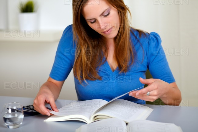 Adult pretty woman reading a book stock photo