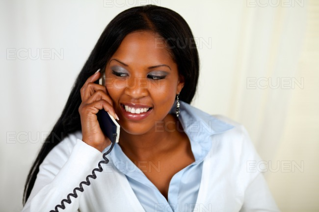 African girl conversing on phone stock photo