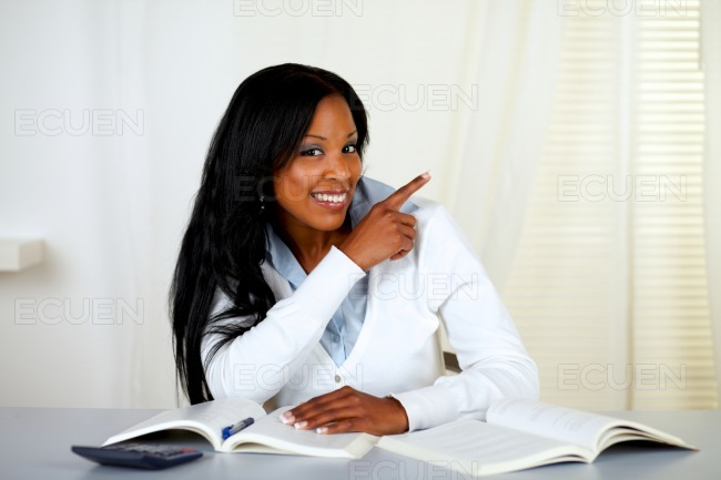 African student smiling and pointing to his left stock photo
