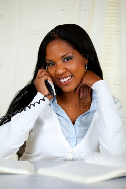 African young woman conversing on phone stock photo