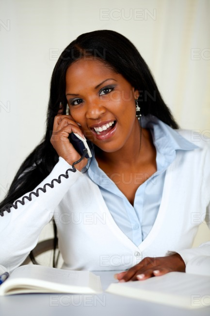 African young woman speaking on phone stock photo