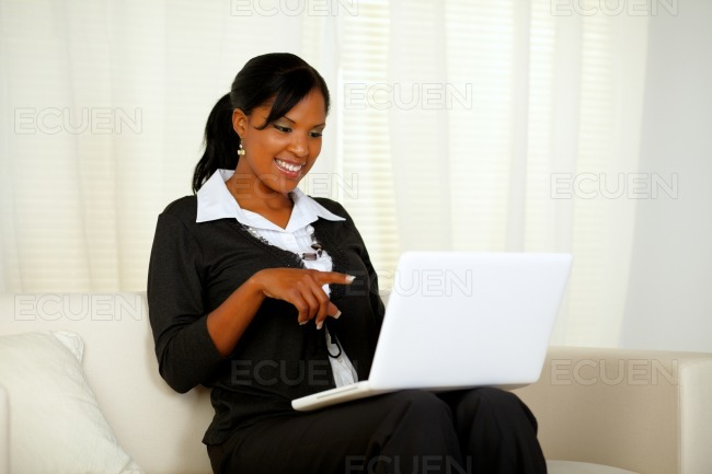 Afro-american businesswoman pointing to laptop stock photo