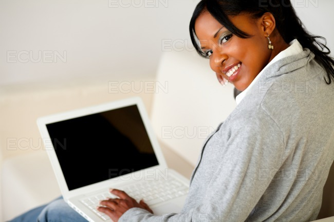 Afro-american female browse the Internet on laptop stock photo