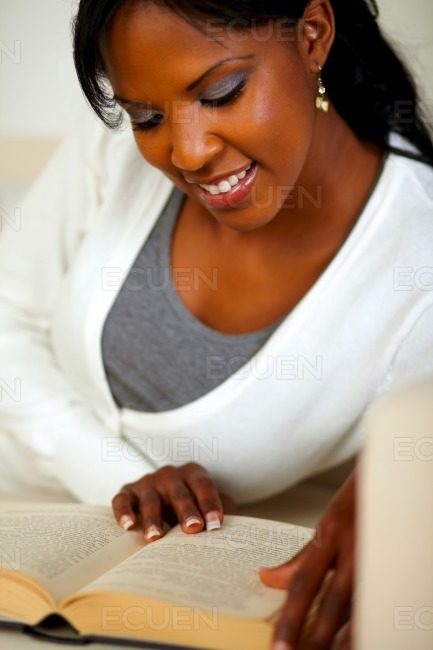Afro-american female reading a book stock photo